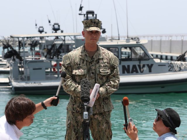 "Cmdr. Sean Kido of the U.S. Navy's 5th Fleet talks to journalists at a 5th Fleet Base near Fujairah, United Arab Emirates, Wednesday, June 19, 2019. Cmdr. Kido said Wednesday that damage done last week to the Kokaku Courageous was ""not consistent with an external flying object hitting the ship."" …"