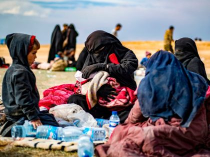 Dorothee Maquere, wife of French jihadist Jean-Michel Clain, sits with four of her five children at a screening area in the eastern Syrian province of Deir Ezzor, after fleeing the Islamic State (IS) group's embattled holdout of Baghouz, on March 5, 2019, during an operation by US-backed Syrian forces to …
