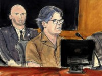 In this courtroom sketch Keith Raniere, second from right, leader of the secretive group NXIVM, attends a court hearing Friday, April 13, 2018, in the Brooklyn borough of New York. In March federal authorities raided an upstate New York residence connected to the group and Raniere, who is accused of …