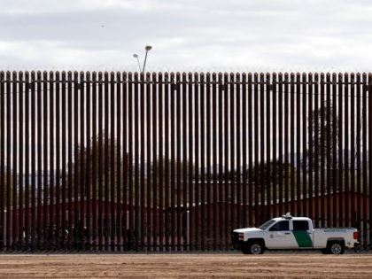 In this April 5, 2019, photo, a U.S. Customs and Border Protection vehicle sits near the a section of the U.S. border wall with Mexico in Calexico, Calif. Democrats controlling the House are trying to use a popular veterans measure to block President Donald Trump from transferring $3.6 billion from …