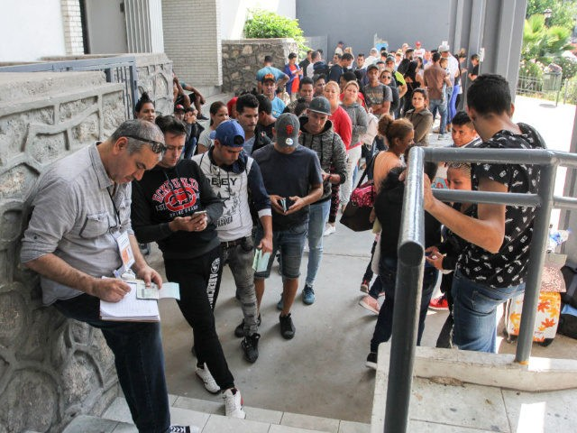 Asylum seekers queue for a turn for an asylum appointment with US authorities in Ciudad Juarez, Chihuahua state, Mexico, on May 31, 2019.