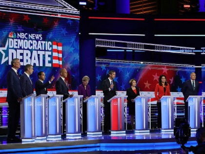 MIAMI, FLORIDA - JUNE 26: Democratic presidential candidates New York City Mayor Bill De Blasio (L-R), Rep. Tim Ryan (D-OH), former housing secretary Julian Castro, Sen. Cory Booker (D-NJ), Sen. Elizabeth Warren (D-MA), former Texas congressman Beto O'Rourke, Sen. Amy Klobuchar (D-MN), Rep. Tulsi Gabbard (D-HI), Washington Gov. Jay Inslee, …