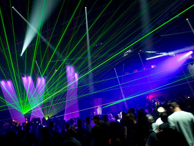 A laser show illuminates a hangar of the former Berlin airport Tempelhof during the Berlin Summer Rave 2012 in Berlin, Germany, early Sunday, July 22, 2012. Some 20.000 fans of electronic music are expected at the 3rd Berlin Summer Rave, a dance party in three hangars and on two extra …