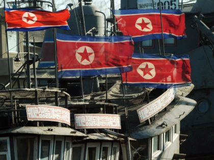 North Korean flags fly at half-mast on fishing boats after the funeral of the late leader Kim Jong-Il, at the Chinese North Korean border area near Dandong on December 29, 2011. North Korea staged a massive memorial service for late leader Kim Jong-Il attended by tens of thousands, and declared …