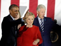 President Barack Obama, Democratic presidential candidate Hillary Clinton and former President Bill Clinton acknowledge the crowd during a campaign event at Independence Mall on Monday, Nov. 7, 2016 in Philadelphia. (AP Photo/Matt Slocum)