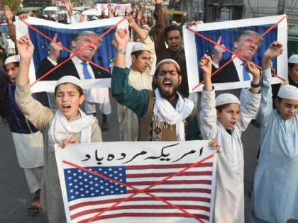 Pakistani demonstrators take part in a protest against US aid cuts in Lahore on January 5, 2018. The United States added bite to its increasingly public spat with Pakistan over militant safe havens December 4, suspending hundreds of millions of dollars in security assistance. President Donald Trump's administration has expressed …