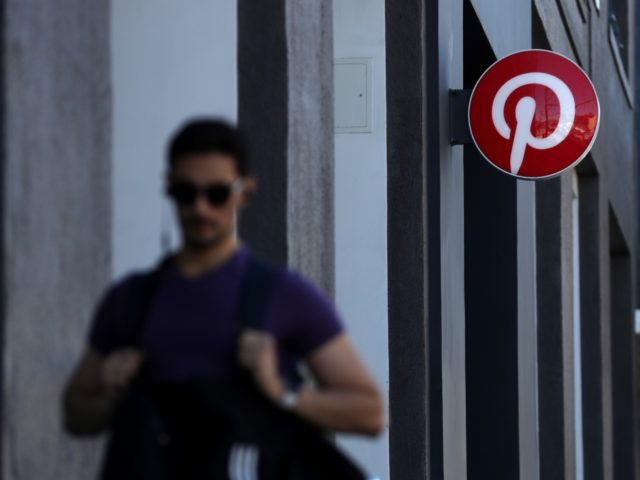 SAN FRANCISCO, CALIFORNIA - APRIL 09: A pedestrian walks by the Pinterest headquarters on April 09, 2019 in San Francisco, California. Social sharing site Pinterest is preparing for its initial public offering (IPO) and is planning to offer 75 million shares with a listing price of $15 to $17 per …