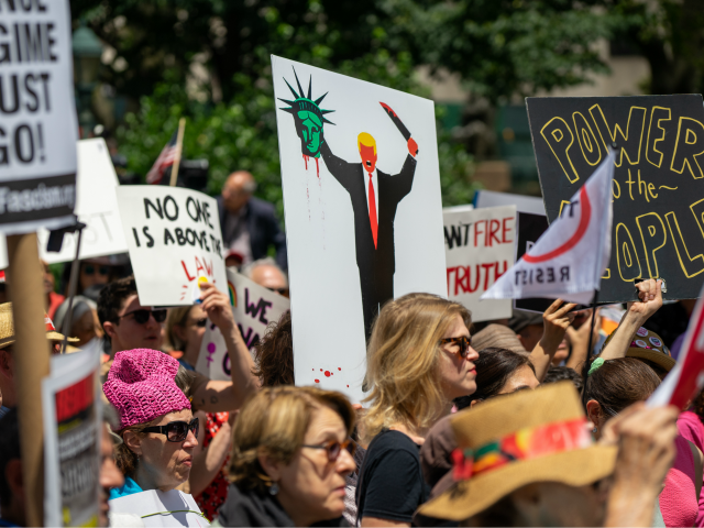 "NEW YORK, NY - JUNE 15: Protestors attend a demonstration calling for the impeachment of U.S. President Donald Trump on June 15, 2019 in New York City. Major cities across the country are expected to hold ""#ImpeachTrump Day of Action"" protests on Saturday to demand that Congress begin impeachment proceedings …"