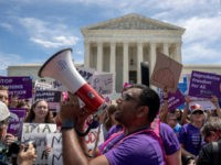 WASHINGTON, DC - MAY 21: Pro-choice protesters gather at the Supreme Court on May 21, 2019 in Washington, DC. The Alabama abortion law, signed by Gov. Kay Ivey last week, includes no exceptions for cases of rape and incest, outlawing all abortions except when necessary to prevent serious health problems …