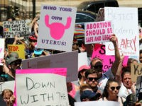 Abortion rights advocates rally in front of the Georgia State Capitol in Atlanta to protest new restrictions on abortions that have been passed in Georgia, May 21, 2019. - Demonstrations were planned across the US on Tuesday in defense of abortion rights, which activists see as increasingly under attack. The …
