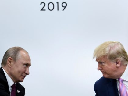 TOPSHOT - US President Donald Trump (R) attends a meeting with Russia's President Vladimir Putin during the G20 summit in Osaka on June 28, 2019. (Photo by Brendan Smialowski / AFP) (Photo credit should read BRENDAN SMIALOWSKI/AFP/Getty Images)