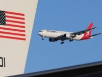 A QANTAS jet flies past the plane of U.S. Secretary of State John Kerry before departing on August 13, 2014 in Sydney, Australia. US Secretary of State John Kerry and Defence Secretary Chuck Hagel were meeting with their Australian counterparts Australian Foreign Minister Julie Bishop and Australian Defence Minister David …