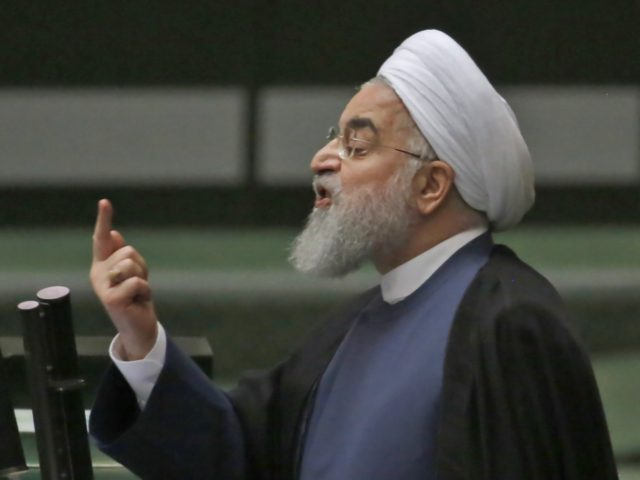 President Hassan Rouhani speaks at the Iranian Parliament in the capital Tehran, on August 28, 2018. - It was the first time Rouhani had been summoned by parliament in his five years in power, with MPs demanding answers on unemployment, rising prices and the collapsing value of the rial, which …