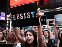 NEW YORK, NY - JULY 26: Dozens of protesters gather in Times Square near a military recruitment center to show their anger at President Donald Trump's decision to reinstate a ban on transgender individuals from serving in the military on July 26, 2017 in New York City. Trump citied the …