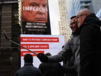 NEW YORK, NY - NOVEMBER 20: A billboard in Times Square, funded by Philanthropist Tom Steyer, calls for the impeachment of President Donald Trump on November 20, 2017 in New York City. Steyer, an American hedge fund manager, environmentalist, progressive activist, and fundraiser has pledged $20 million for an ad …