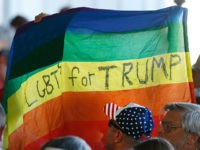 GRAND JUNCTION, CO - OCTOBER 18: Supporters hold up a gay pride flag for Republican presidential candidate Donald Trump on October 18, 2016 in Grand Junction Colorado. Trump is on his way to Las Vegas for the third and final presidential debate against Democratic rival Hillary Clinton. (Photo by George …