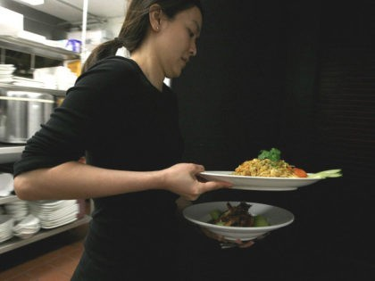 MAY 05: A waitress at Osha Thai Restaurant carries plates of food along with bowls of jasmine rice May 5, 2008 in San Francisco, California. As rice prices continue to climb and some places are limiting the number of bags small businesses can purchase, many Bay Area restaurants are being …