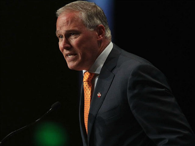 CEDAR RAPIDS, IOWA - JUNE 09: Democratic presidential candidate and Washington governor Jay Inslee speaks at the Iowa Democratic Party's Hall of Fame Dinner on June 9, 2019 in Cedar Rapids, Iowa. Nearly all of the 23 Democratic candidates running for president were campaigning in Iowa this weekend. President Donald …
