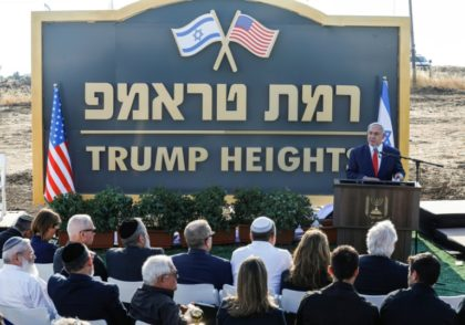 "Israeli Prime Minister Benjamin Netanyahu gives a speech in front of the newly-unveiled sign ""Ramat Trump"", or ""Trump Heights"" in English, named after the incumbent US president in the Israeli-annexed Golan Heights on Sunday"