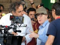 US film director Woody Allen (C) chats with his team on the set of his new film The Bop Decameron at Rome's Termini train station on July 14, 2011. The movie, being shot in several locations of the Italian capital, will be a comedy inspired by Giovenni Boccacio's The Decameron. …