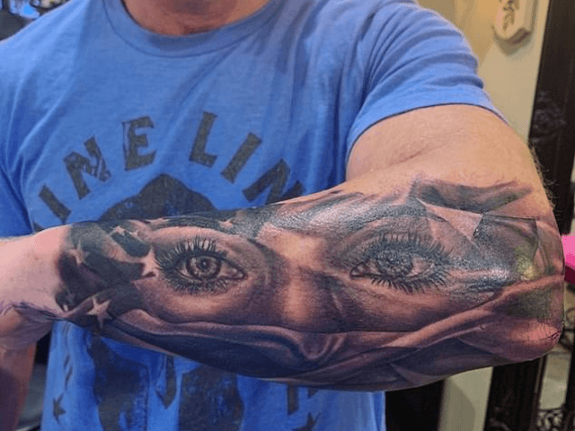 Navy SEAL Eddie Gallagher, 40, has celebrated being cleared of the murder of an Islamic State captive by getting a huge tattoo of his wife's eyes