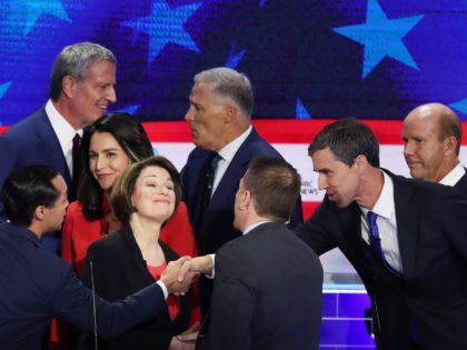 MIAMI, FLORIDA - JUNE 26: Chuck Todd of NBC News greets Sen. Amy Klobuchar (D-MN), former housing secretary Julian Castro, former Texas congressman Beto O'Rourke and other candidates after the first night of the Democratic presidential debate on June 26, 2019 in Miami, Florida. A field of 20 Democratic presidential …