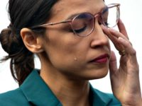 Representative Alexandria Ocasio-Cortez sheds a tear during a February 7 press conference calling on Congress to cut funding for U.S. Immigration and Customs Enforcement and defund border detention facilities. SAUL LOEB/AFP/GETTY IMAGES