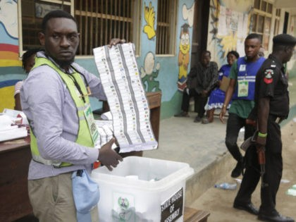 An electoral commission official count ballots papers after the gubernatorial election in Lagos, Nigeria, Saturday March. 9, 2019. Nigeria goes to the polls on Saturday to elect state Governors and state House of assembly. (AP Photo/Sunday Alamba)