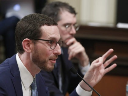State Sen. Scott Wiener, D-San Francisco, left, discusses his housing measure during a committee hearing Wednesday, April 24, 2019, in Sacramento, Calif. Wiener's bill, SB50, that would increase housing near transportation and job hubs was approved by the Senate Governance and Finance Committee, after it was merged with SB4, a …