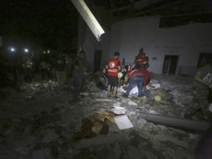 Libyan Red Crescent workers recover migrants bodies after an airstrike at a detention center in Tajoura, east of Tripoli Wednesday, July 3, 2019. An airstrike hit the detention center for migrants early Wednesday in the Libyan capital. (AP Photo/Hazem Ahmed)