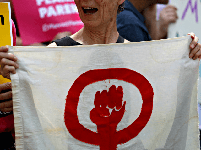 Abortion-rights supporters take part in a protest Thursday, May 30, 2019, in St. Louis. A St. Louis judge heard an hour of arguments Thursday on Planned Parenthood's request for a temporary restraining order that would prohibit the state from allowing the license for Missouri's only abortion clinic to lapse at …