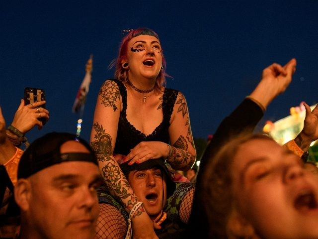 GLASTONBURY, ENGLAND - JUNE 29: Festival-goers react as The Killers perform on the Pyramid Stage on day four of Glastonbury Festival at Worthy Farm, Pilton on June 29, 2019 in Glastonbury, England. Glastonbury is the largest greenfield festival in the world, and is attended by around 175,000 people. (Photo by …