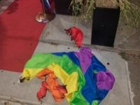 A burned rainbow flag lays on the stoop of the Alibi Lounge, early Monday, July 8, 2019, in New York City, New York. The owner of a New York City gay bar says a rainbow flag was set aflame at the club's entrance for the second time in just over …