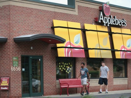 An Applebee's restaurant serves customers on August 10, 2017 in Chicago, Illinois. DineEquity, the parent company of Applebee's and IHOP, plans to close up to 160 restaurants in the first quarter of 2018. The announcement helped the stock climb more than 4 percent today. (Photo by Scott Olson/Getty Images)