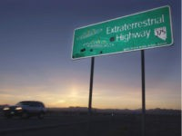 "FILE - In this April 10, 2002, file photo, a car moves along the Extraterrestrial Highway near Rachel, Nev, the closest town to Area 51. The U.S. Air Force is giving an ultimatum to owners of the remote Nevada property: Take a $5.2 million ""last best offer"" by Thursday,, Sept. …"