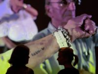 Former Nazi concentration camp Auschwitz survivors show their tattooed prisoners' numbers in a movie during the press preview of the tattoo and piercing exhibition 'Grassi Invites # 4 Tattoo & Piercing: A World Skin-Deep. (un)covered' in Leipzig, Germany, Thursday, Sept. 21, 2017. The exhibition starts on Sept. 22, 2017 and …