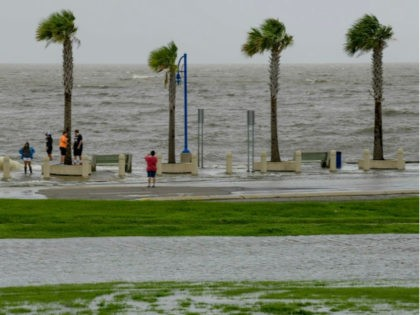 People check out the waves on Lakeshore Drive in New Orleans, Friday, July 12, 2019, as water moves in from Lake Pontchartrain from the storm surge from Tropical Storm Barry in the Gulf of Mexico. The area is behind a levee that protects the rest of the city. Barry could …