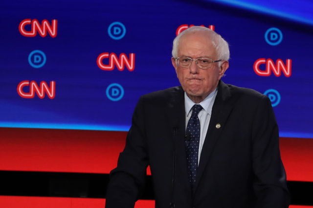 DETROIT, MICHIGAN - JULY 30: Democratic presidential candidate Sen. Bernie Sanders (I-VT) gestures during the Democratic Presidential Debate at the Fox Theatre July 30, 2019 in Detroit, Michigan. 20 Democratic presidential candidates were split into two groups of 10 to take part in the debate sponsored by CNN held over …