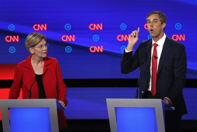 DETROIT, MICHIGAN - JULY 30: Democratic presidential candidate former Texas congressman Beto O'Rourke (R) speaks while Sen. Elizabeth Warren (D-MA) listens during the Democratic Presidential Debate at the Fox Theatre July 30, 2019 in Detroit, Michigan. 20 Democratic presidential candidates were split into two groups of 10 to take part …