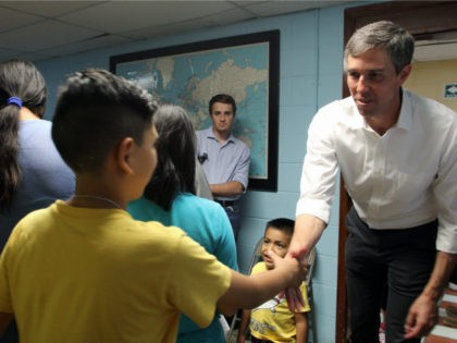 "Mexican former congressman and presidential candidate hopeful for the Democratic Party, Beto O'Rourke (R), shakes hands with a Central American migrant child during a visit at the ""House of the migrant"" shelter in Ciudad Juarez, Chihuahua State, Mexico on June 30, 2019. (Photo by HERIKA MARTINEZ / AFP) (Photo credit …"