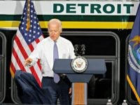 Vice President Joe Biden throws his coat down before speaking in Detroit, Thursday, Sept. 17, 2015. Biden spoke on how federal investments are helping Detroit's economic revitalization efforts. (AP Photo/Paul Sancya)