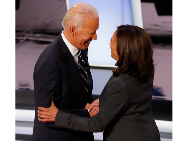 Former Vice President Joe Biden and Sen. Kamala Harris, D-Calif., shake hands before the second of two Democratic presidential primary debates hosted by CNN Wednesday, July 31, 2019, in the Fox Theatre in Detroit. (AP Photo/Paul Sancya)
