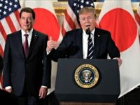 President Donald Trump speaks with Japanese business leaders, Saturday, May 25, 2019, in Tokyo, as U.S. Ambassador to Japan William Hagerty listens. (AP Photo/Evan Vucci)