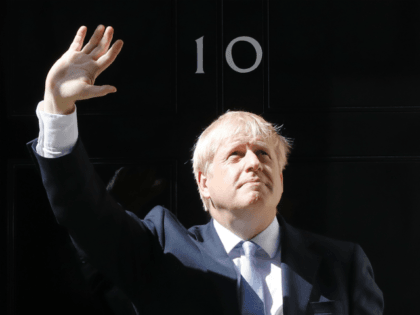 """Britain's new Prime Minister Boris Johnson gestures after giving a speech outside 10 Downing Street in London on July 24, 2019 on the day he was formally appointed British prime minister. - Boris Johnson took over as Britain's new prime minister on Wednesday vowing to prove the """"gloomsters"""" wrong and …"""
