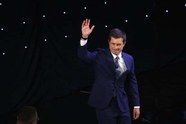 DETROIT, MICHIGAN - JULY 30: Democratic presidential candidate South Bend, Indiana Mayor Pete Buttigieg takes the stage at the beginning of the Democratic Presidential Debate at the Fox Theatre July 30, 2019 in Detroit, Michigan. 20 Democratic presidential candidates were split into two groups of 10 to take part in …