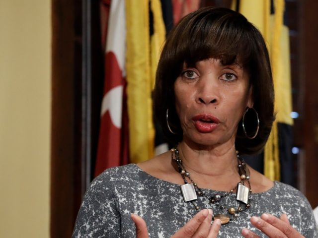 In this Tuesday, April 4, 2017 file photo, Baltimore Mayor Catherine Pugh, left, speaks alongside Baltimore Police Department Commissioner Kevin Davis at a news conference at City Hall in Baltimore, in response to the Department of Justice's request for a 90-day delay of a hearing on its proposed overhaul of …