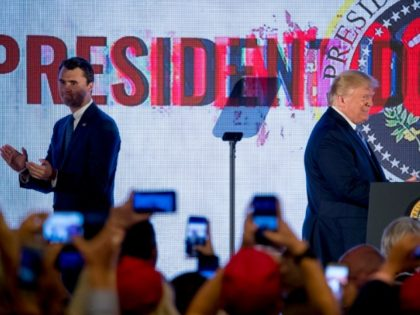 President Donald Trump, left, accompanied by Turning Point USA Founder Charlie Kirk, right, takes the stage at Turning Point USA Teen Student Action Summit at the Marriott Marquis in Washington, Tuesday, July 23, 2019. (AP Photo/Andrew Harnik)