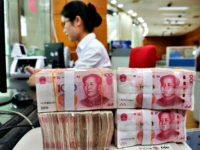 An employee counts 100-yuan notes at a bank in Nantong in China's eastern Jiangsu province on July 23, 2018. (AFP/Getty Images)