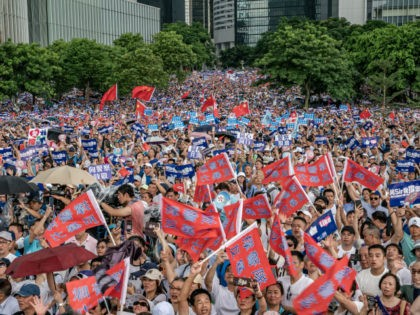 Demonstrators wave Chinese flags and shout slogan during a rally on June 30, 2019 in Hong Kong, China. Tens of thousands of demonstrators gather outside Legislative Council Complex to show their support to the police as they fought largely young demonstrators opposed to a now postponed plan to allow extraditions …