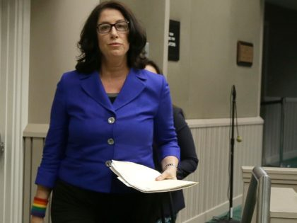 In this Tuesday, Nov. 28, 2017, photo, Christine Pelosi, chair of the California Democratic Party's women's caucus, walks to the dais to speak before the Assembly Rules Subcommittee on Harassment, Discrimination and Retaliation Prevent and Response, in Sacramento, Calif. U.S. House Minority Leader Nancy Pelosi's daughter, Christine, is sharply criticizing …